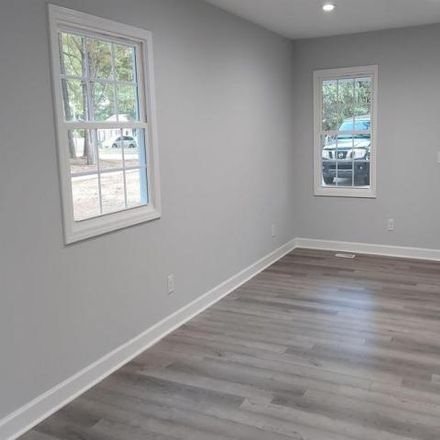 Rent this 3 bed house on 7604 Summerglenn Drive in Raleigh, NC 27615