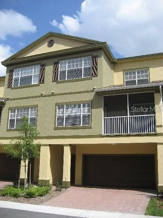 Rent this 3 bed townhouse on Grand Central Pkwy in Orlando, FL