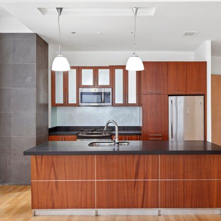 Rent this 3 bed loft on Real Deal in 59 John Street, New York