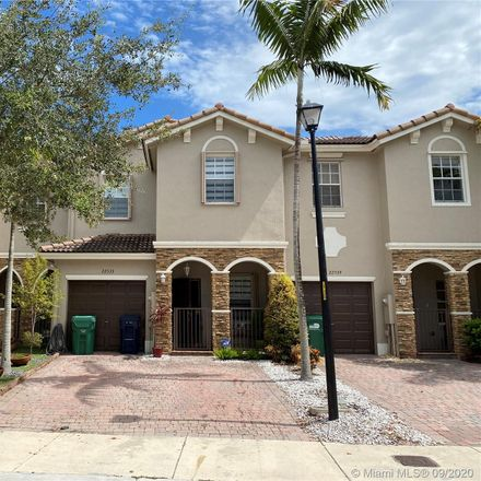 Rent this 3 bed townhouse on 22533 Southwest 88th Path in Lakes by the Bay, FL 33190