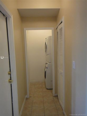 Rent this 3 bed townhouse on 14179 Southwest 126th Place in Three Lakes, FL 33186