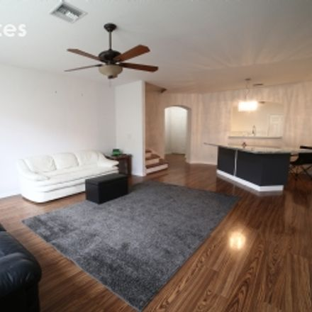 Rent this 4 bed townhouse on Cleveland Avenue in Fort Myers, FL 33901