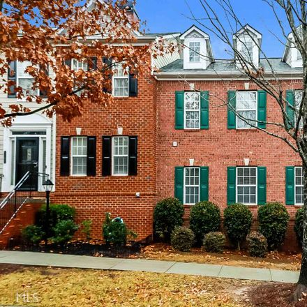 Rent this 3 bed townhouse on Station Center Blvd in Suwanee, GA