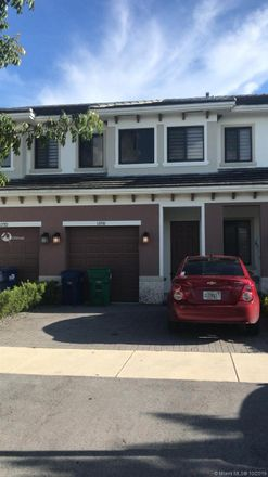 Rent this 3 bed townhouse on 12776 Southwest 131st Terrace in Three Lakes, FL 33186