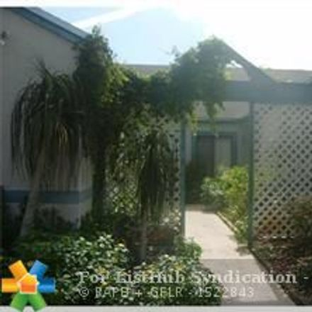 Rent this 2 bed townhouse on 7450 Northwest 34th Street in Lauderhill, FL 33319