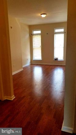 Rent this 2 bed townhouse on 2022 Saint Paul Street in Baltimore, MD 21218
