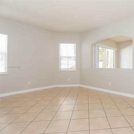 Rent this 4 bed house on Northwest 87th Place in Hialeah Gardens, FL 33018