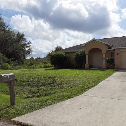 Rent this 4 bed house on 2521 69th Street W in Lehigh Acres, FL 33971