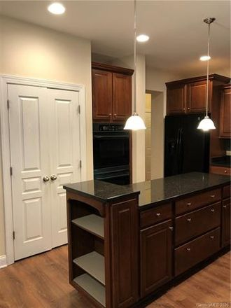 Rent this 4 bed house on 9430 Chanson Place in Matthews, NC 28105