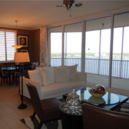 Rent this 3 bed condo on W 1st St in Fort Myers, FL