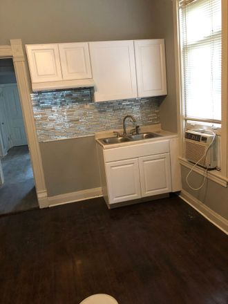 Rent this 2 bed townhouse on W Thomas St in Chicago, IL