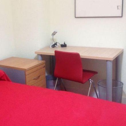 Rent this 6 bed room on Plaza de la Virgen del Trabajo in Avenida Veinticinco de Septiembre, 28001 Madrid