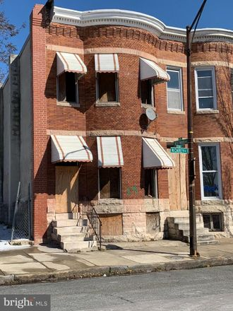 Rent this 3 bed townhouse on 1743 North Carey Street in Baltimore, MD 21217