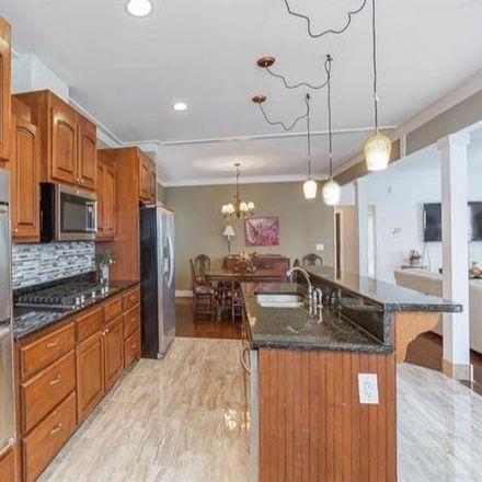 Rent this 4 bed house on 1935 John Calvin Avenue in Atlanta, GA 30337