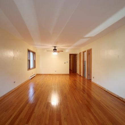 Rent this 2 bed townhouse on North Artesian Avenue in Chicago, IL 60625