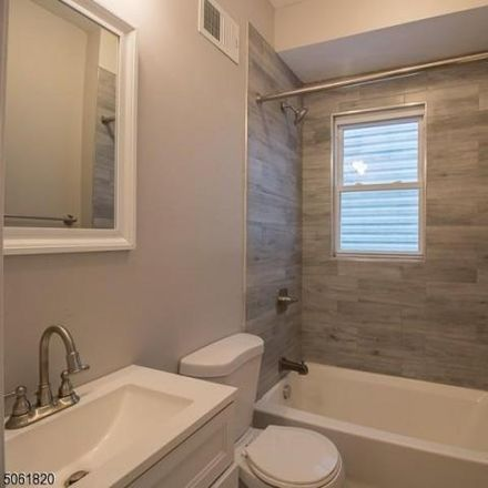Rent this 3 bed apartment on 56 New Street in East Orange, NJ 07017