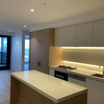 Rent this 2 bed apartment on 2501/545 Station Street