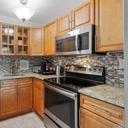 Rent this 3 bed condo on 10-24 166th Street in New York, NY 11357