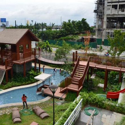 Rent this 3 bed condo on The Almond; Section A in McKinley Parkway, Taguig