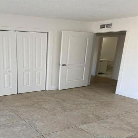 Rent this 2 bed condo on 6930 Northwest 186th Street in Country Club, FL 33015