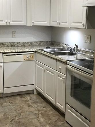 Rent this 2 bed condo on Fox Chase Cir N in Palm Harbor, FL