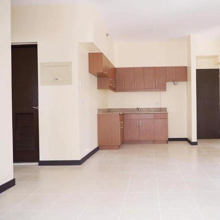 Rent this 3 bed condo on Belmira Building in Pamayanang Diego Silang Avenue, Taguig