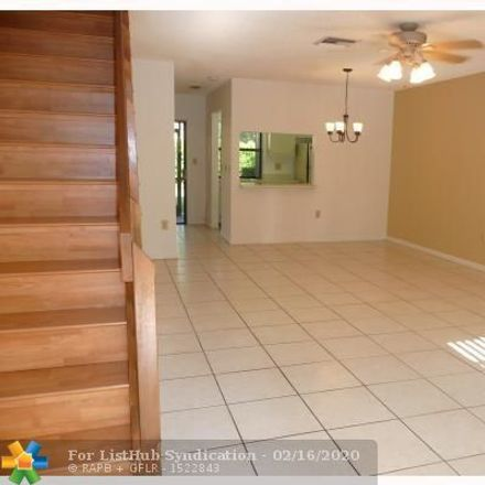 Rent this 2 bed townhouse on 586 Westree Lane in Plantation, FL 33324