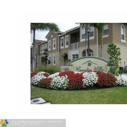 Rent this 3 bed townhouse on Lantana Ln in Fort Lauderdale, FL