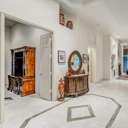 Rent this 3 bed house on Island Cove Way in West Palm Beach, FL