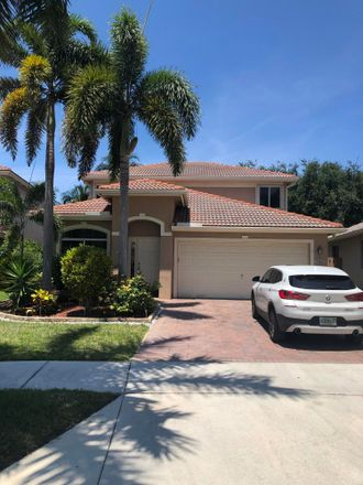 Rent this 4 bed house on 3763 Woodfield Drive in Coconut Creek, FL 33073