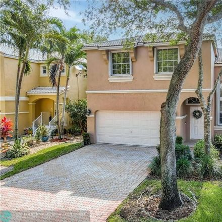 Rent this 4 bed house on NW 49th Dr in Pompano Beach, FL