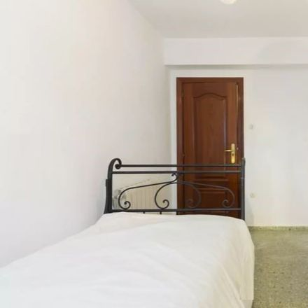 Rent this 4 bed room on Campo de Fútbol Gabriel Fernández in Calle Cuart de Poblet, 28001 Madrid