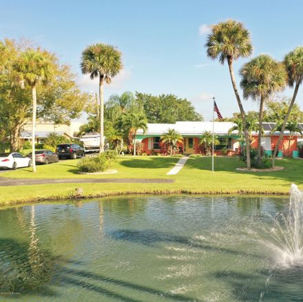 Rent this 4 bed house on North Tropical Trail in Merritt Island, FL 32953