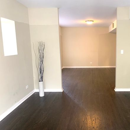 Rent this 2 bed townhouse on 1707 North Long Avenue in Chicago, IL 60639