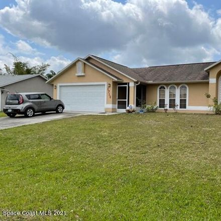 Rent this 3 bed house on Parrsboro St NW in Palm Bay, FL