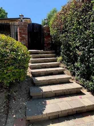Rent this 3 bed house on 7711 Woodhall Avenue in Los Angeles, CA 91304
