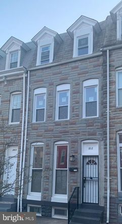 Rent this 3 bed townhouse on 1812 North Caroline Street in Baltimore, MD 21213