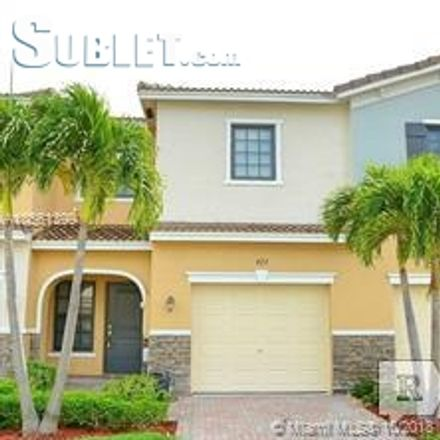 Rent this 3 bed townhouse on 427 Northeast 194th Terrace in Andover Lakes Estates, FL 33179