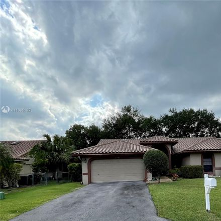Rent this 4 bed house on NW 97th Ln in Pompano Beach, FL