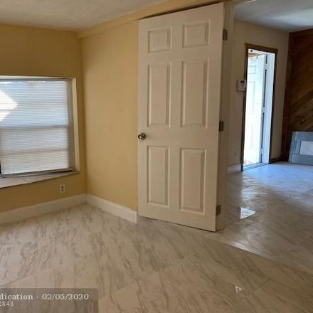 Rent this 3 bed house on Northeast 13th Terrace in Pompano Beach, FL 33064
