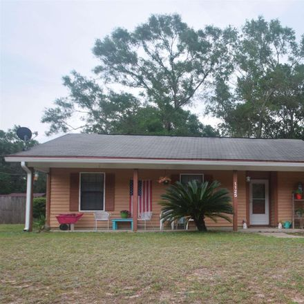 Rent this 3 bed house on Woodlake Dr in Cantonment, FL