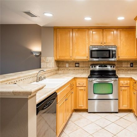 Rent this 3 bed condo on Stanford Court in Irvine, CA 92612