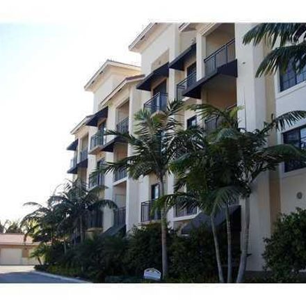 Rent this 2 bed condo on 4903 Midtown Lane in Palm Beach Gardens, FL 33418