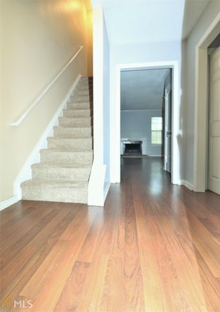 Rent this 3 bed townhouse on Grist Mill Dr in Marietta, GA
