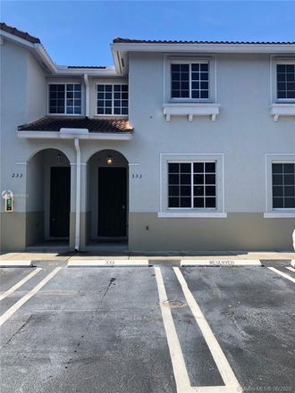 Rent this 3 bed townhouse on 21111 Northwest 14th Place in Andover, FL 33169