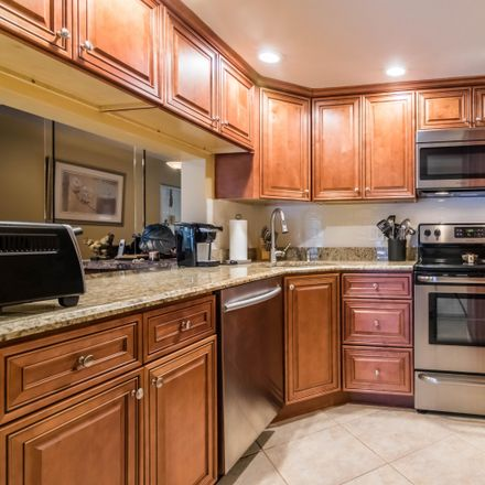 Rent this 2 bed condo on Sky Pine Way in Greenacres, FL 33415