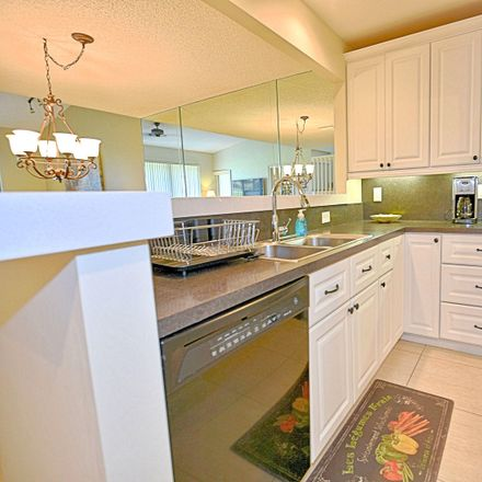 Rent this 2 bed townhouse on 503 Prestwick Circle in Palm Beach Gardens, FL 33418