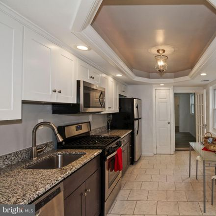 Rent this 3 bed townhouse on 242 South Castle Street in Baltimore, MD 21231