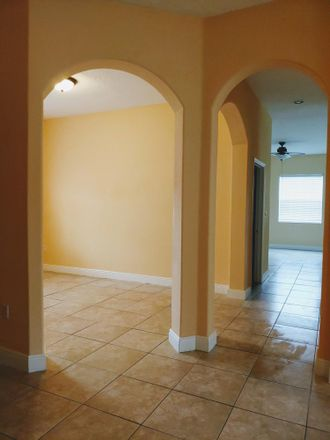 Rent this 3 bed house on SW Savage Blvd in Port Saint Lucie, FL