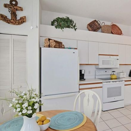 Rent this 3 bed townhouse on Winding Oaks Cir W in Vero Beach, FL